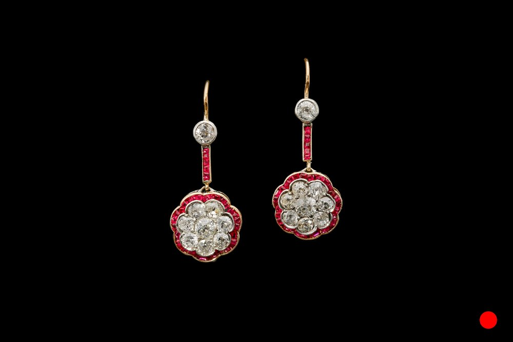 A pair of late Art Nouveau ruby and diamond floral drop earrings set   £8650