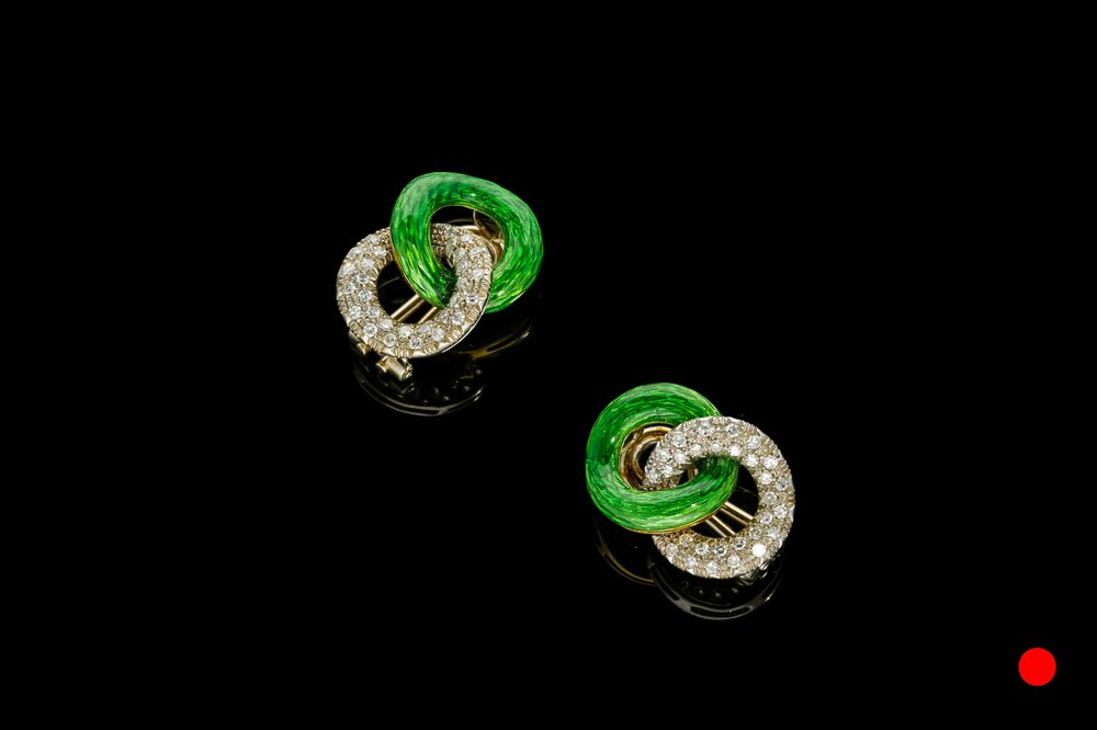 A pair of 1940's vibrant green guilloche enamel and diamond clip earrings set   £5450