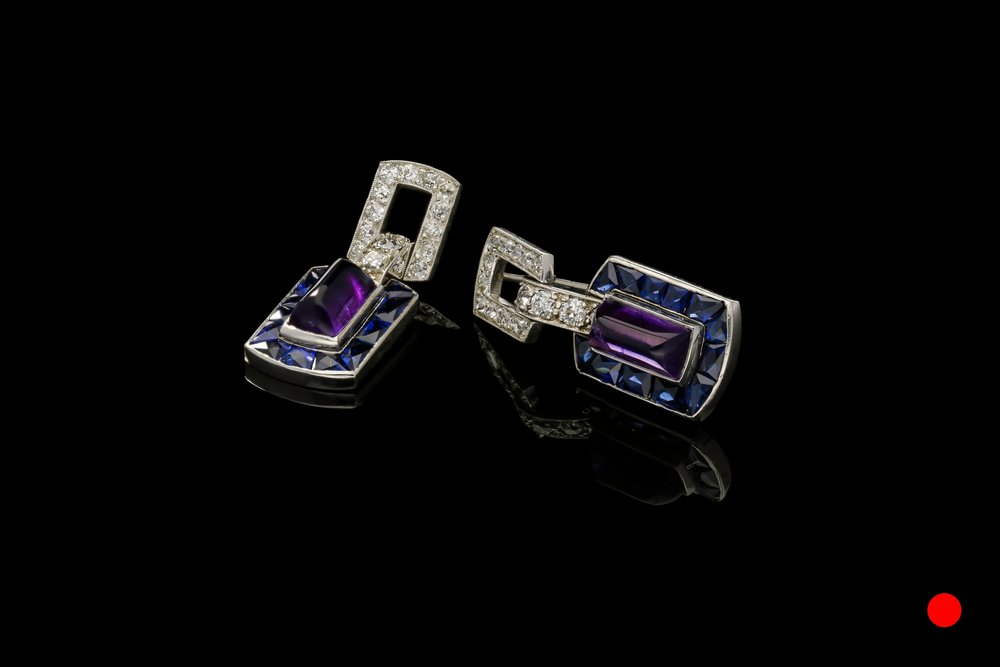 A striking pair of 1940's sugarloaf amethyst, sapphire and diamond earrings set | £8750