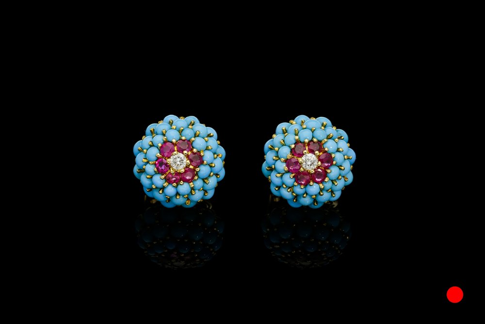 A stylish pair of 1950's turquoise, diamond and Burmese ruby earrings set   £6975