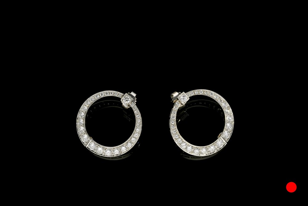 An ingenious pair of Art Deco platinum and diamond hinged wrap around hoop earrings   £7450
