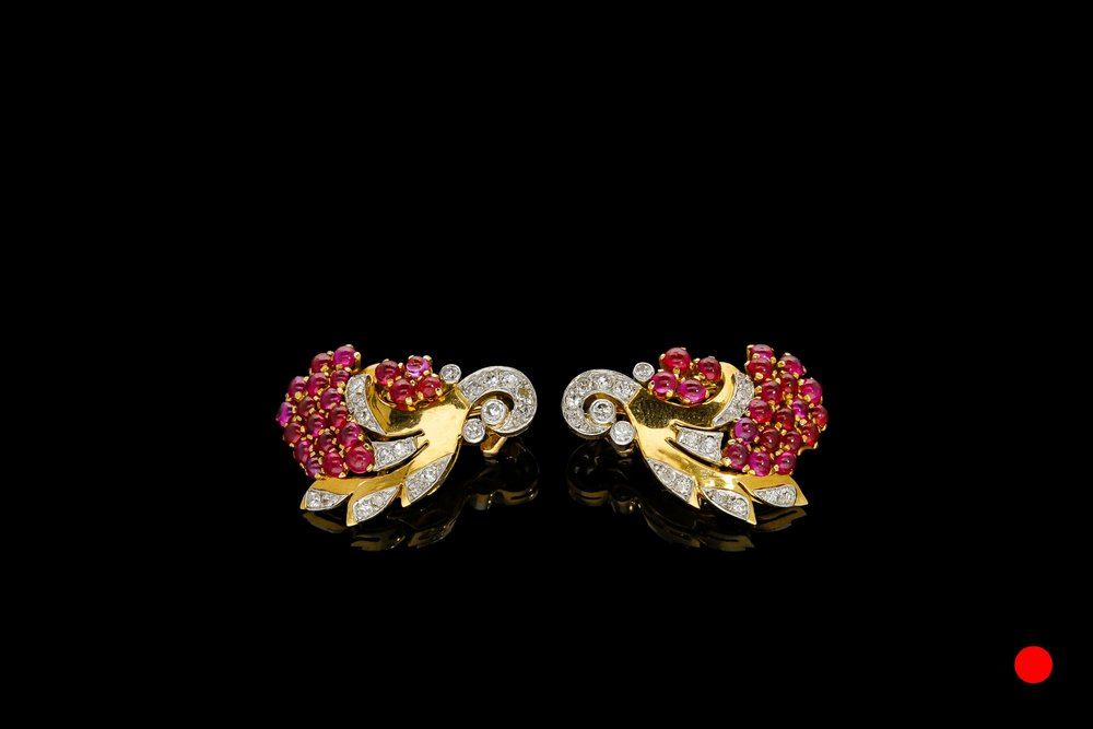 A fantastic pair of 1940's cabochon ruby and diamond clip earrings set   £5100