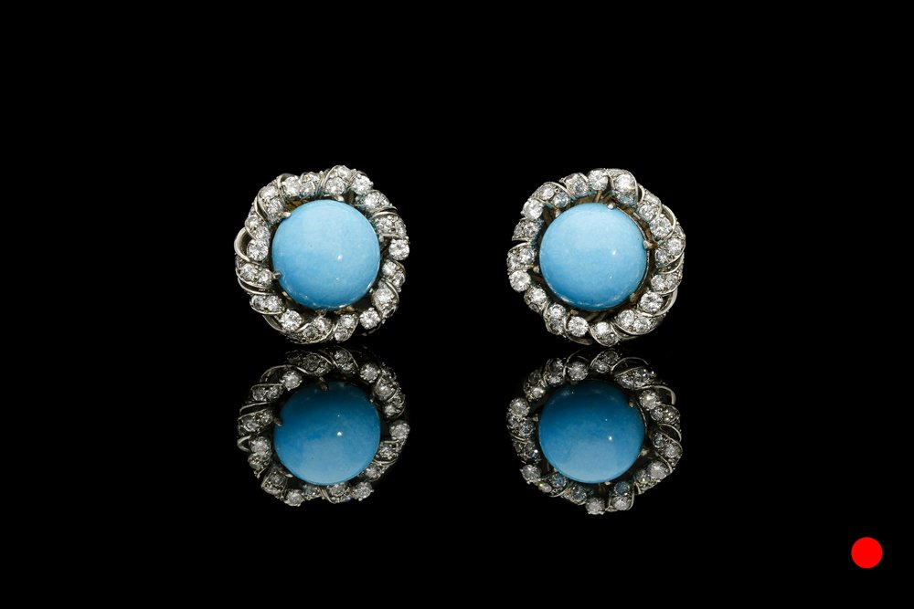 A vibrant pair of 1940's turquoise and diamond clip earrings set   £5850