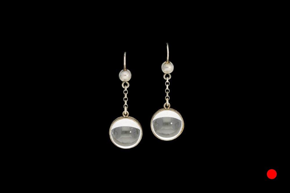 A phenomenal pair of Art Deco 'pools of light' earrings set in silver   £650