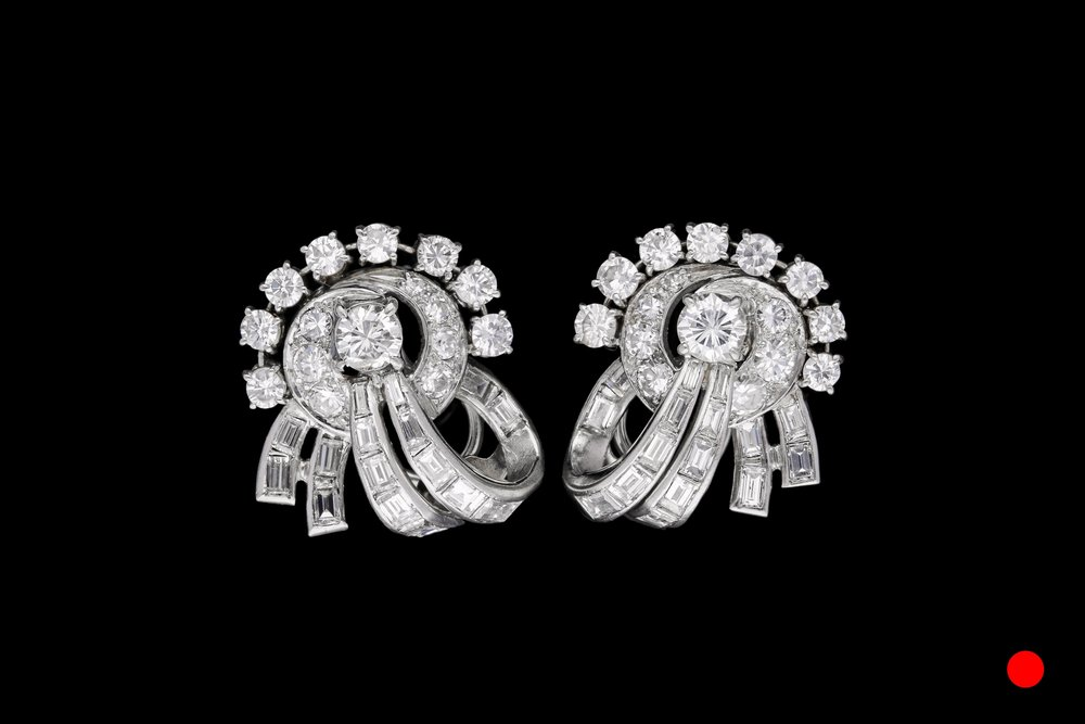 A pair of platinum 1950's diamond set clip earrings   £13500
