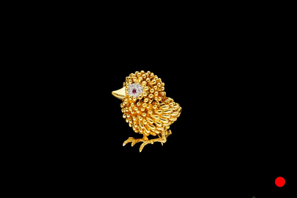 A gold 1950's Kutchinsky bird brooch | £3600