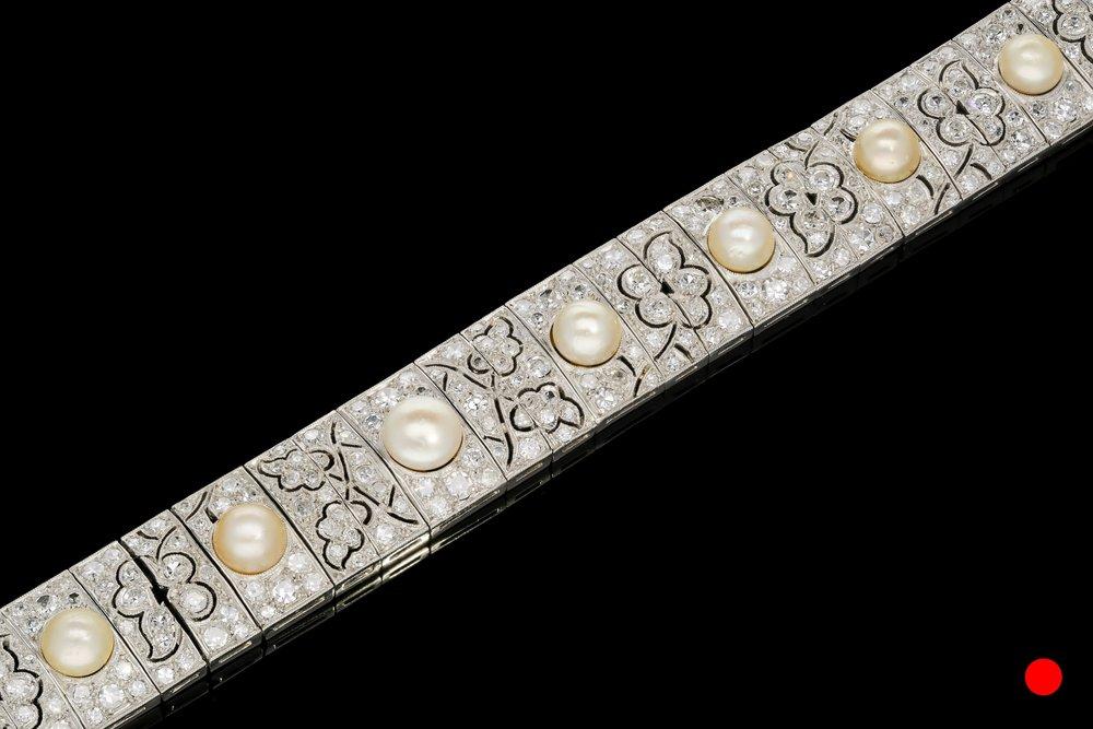 A 1920's natural floral panel bracelet set | £21500