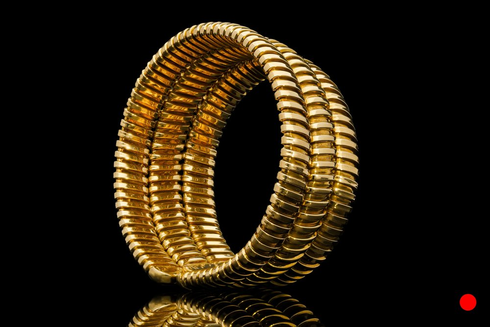 A 1960's gold three-tiered bangle   £5950