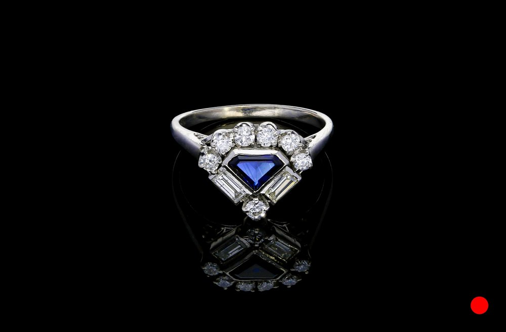 A 1950's 18ct shield ring   £2975