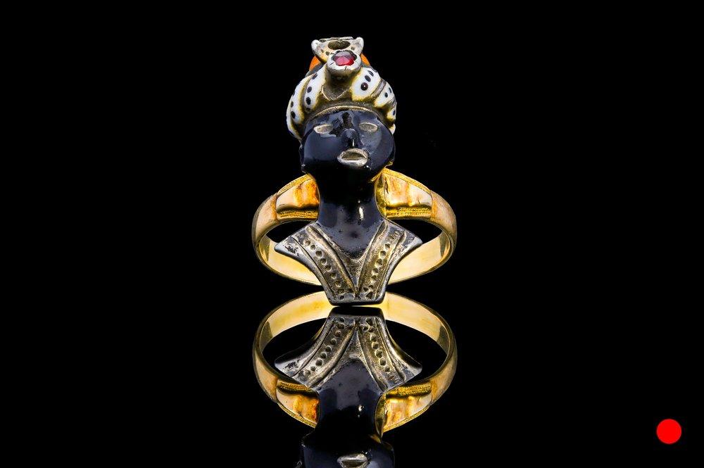 A Georgian ruby & coral blackamoor ring | £1920