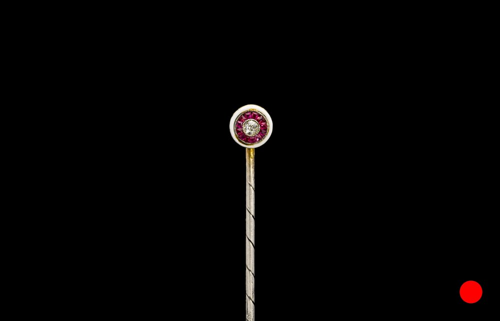 A 1940's white enamel stick pin | £1200