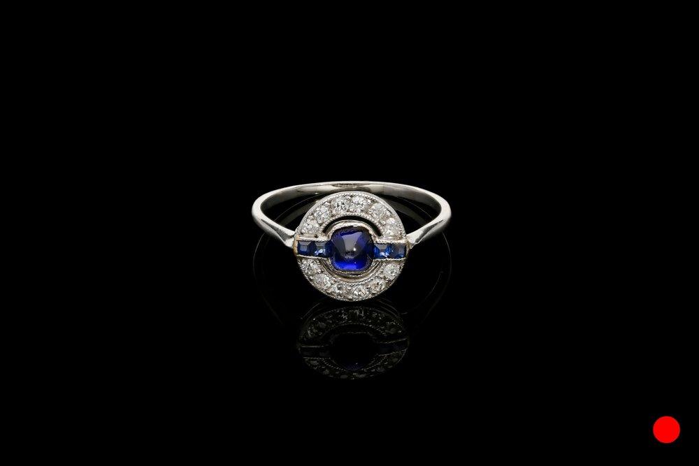 An Art Deco cabochon ring set   £2950
