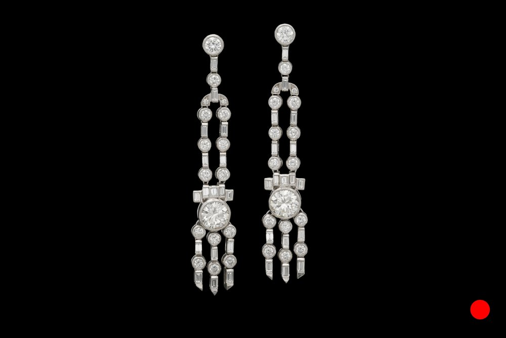 A stunning pair of iconic Art Deco platinum and diamond chandelier drop earrings   £19850