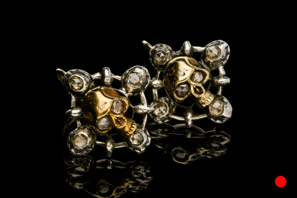 An unusual pair of momento mori Georgian gold and silver skull earrings set   £4800
