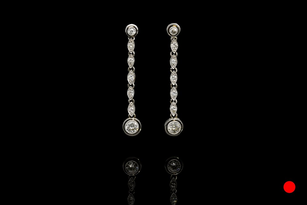 A stylish pair of 1950's transitional round brilliant cut diamond drop earrings set   £6450