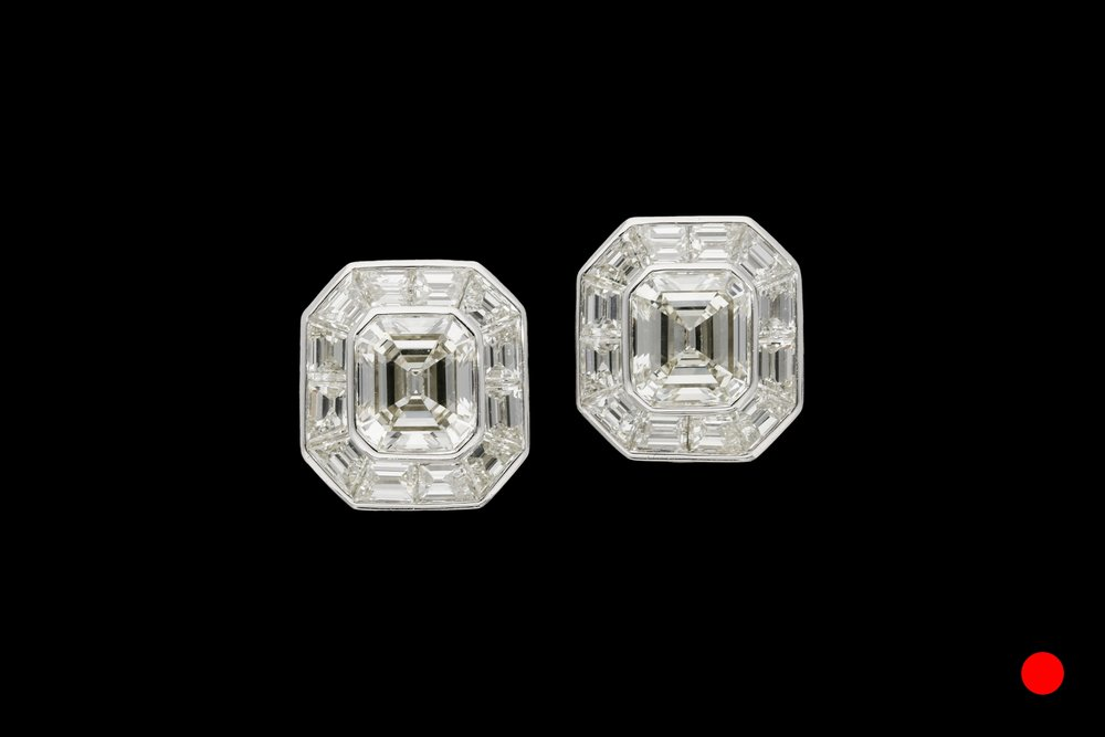 An incredible pair of Art Deco style emerald cut diamond cluster stud earrings set | £46000