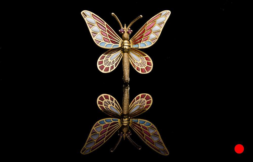 A 1950's plique-a-jour butterfly brooch | £2450