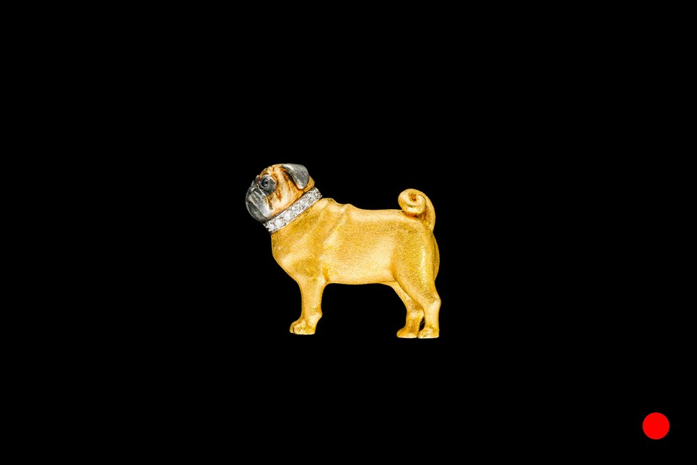 A 1970's E. Wolfe & Co gold pug brooch | £3850