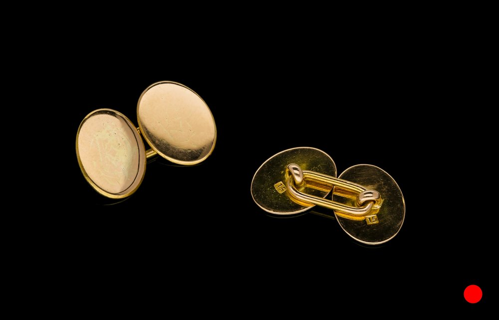 A Victorian 15ct oval cufflinks | £825