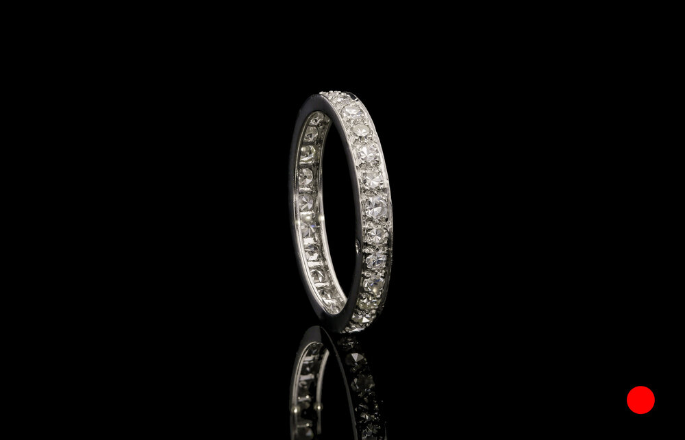 A French 1920's platinum Old European cut diamond eternity ring   £2960