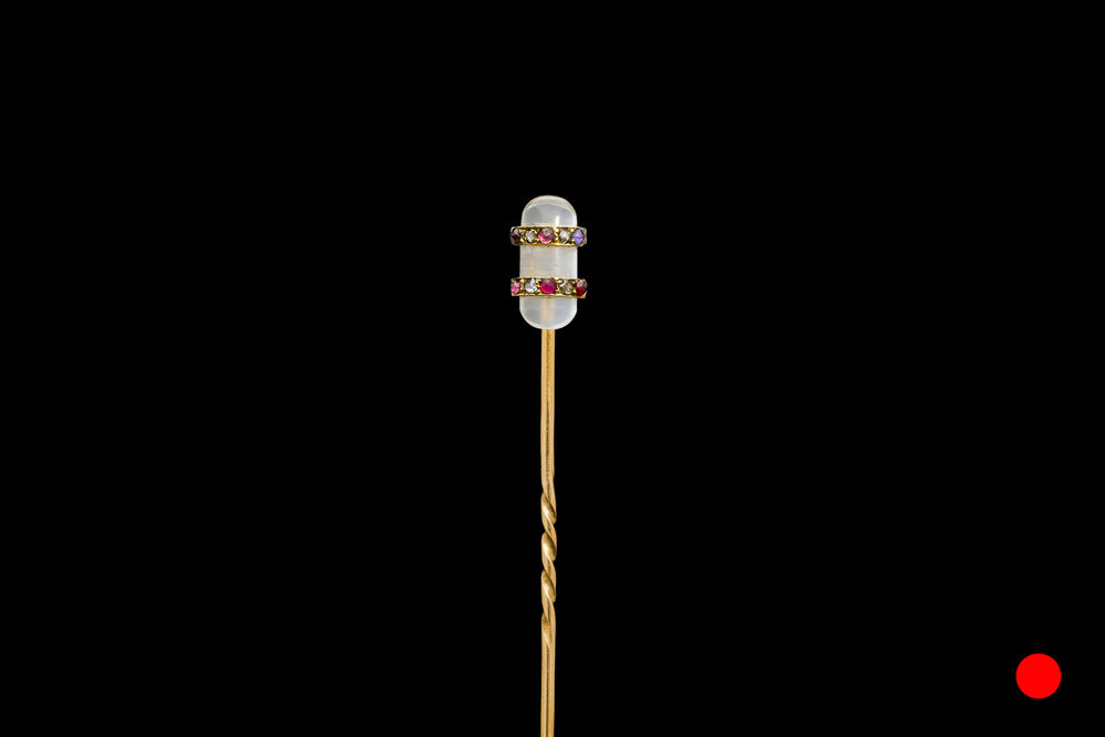 A moonstone pill stick pin | £1400