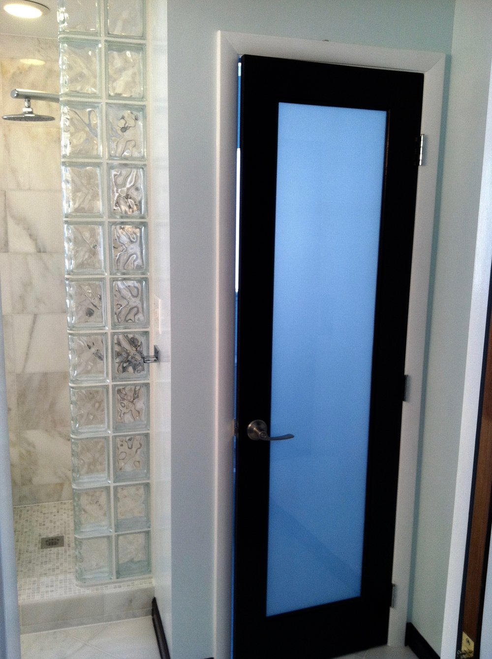Frosted glass allows lighting while protecting privacy
