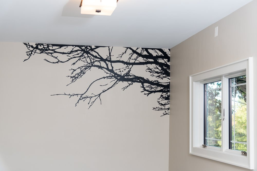 A detailed silhouette painting decorates this feature wall