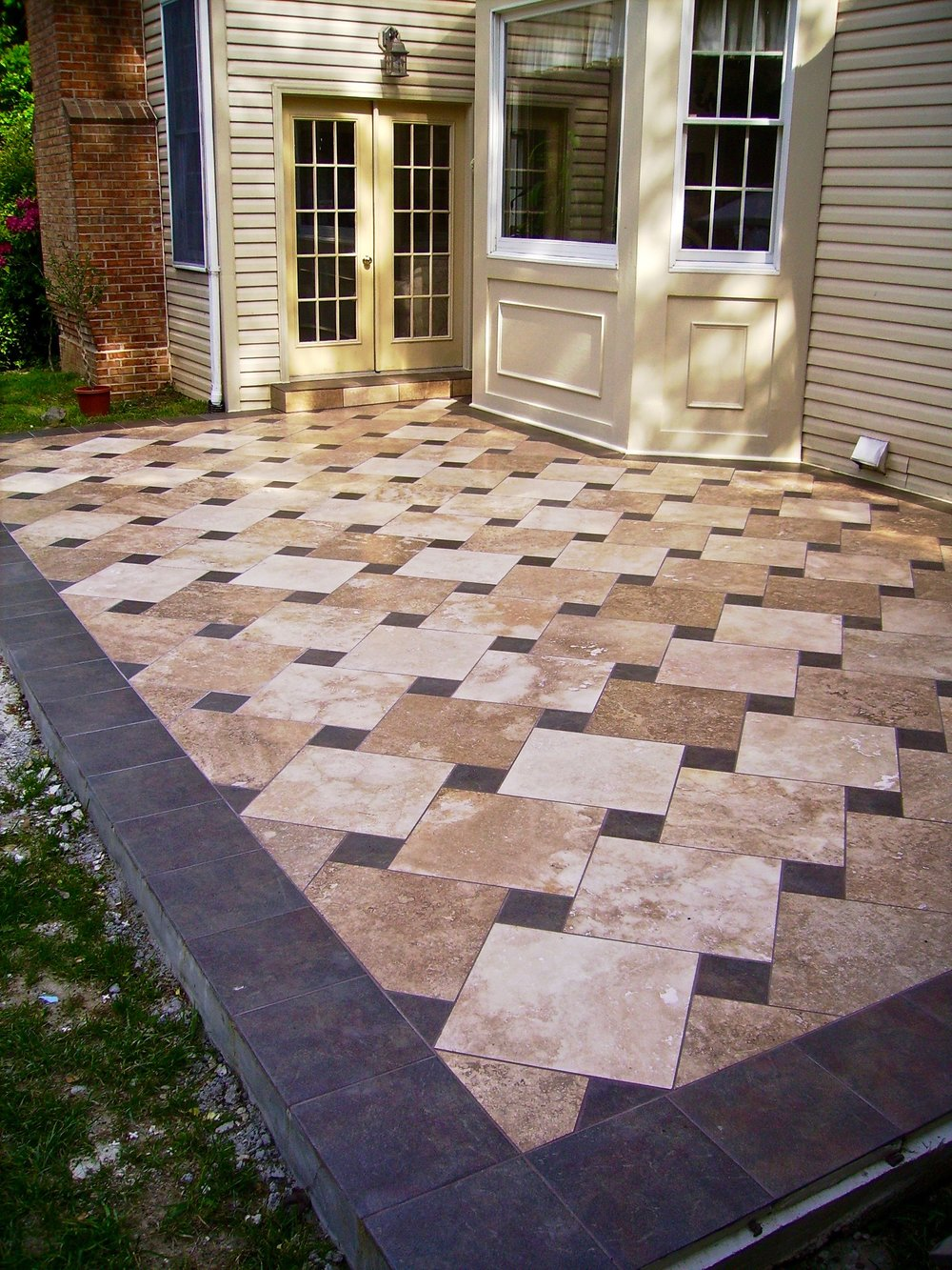 Pretty contrasting tiles cover this patio