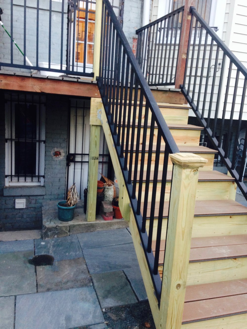 Brand new stairs and railing connect both outdoor levels of this house