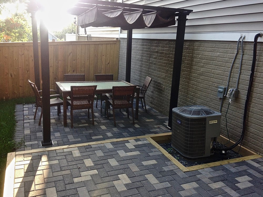A new patio is furnished for outdoor gatherings
