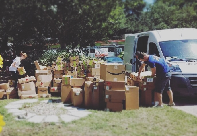 Volunteers working on hundreds of Amazon donations received at Austin Pets Alive.
