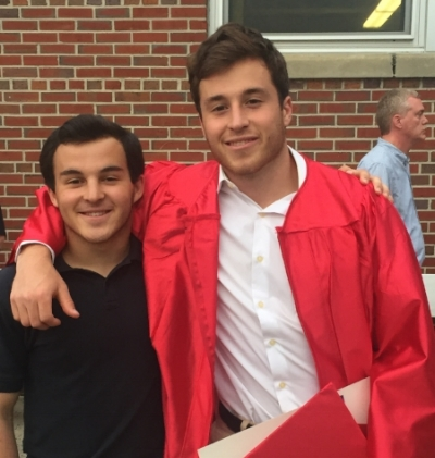 Andrew (on the right) at his high school graduation, and Dean on the left