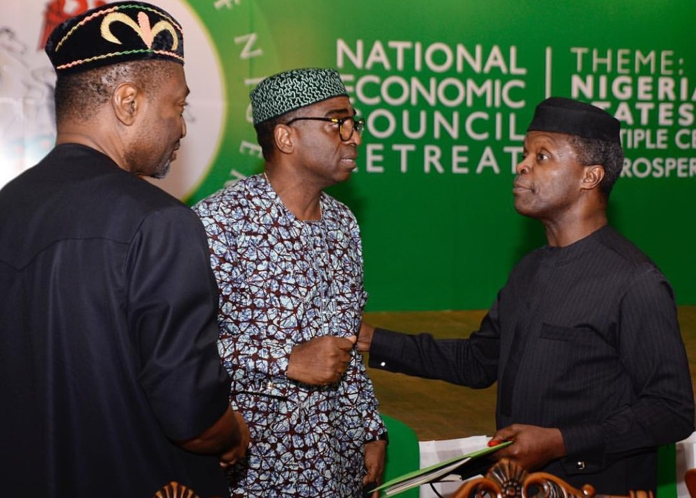 Prof. Yemi Oshinbajo, Vice President, Federal Republic of Nigeria (R), and Sen. Udo Udoma Udoma, Hon. Minister, Budget and National planning (L) with Olusegun Awolowo (M)s