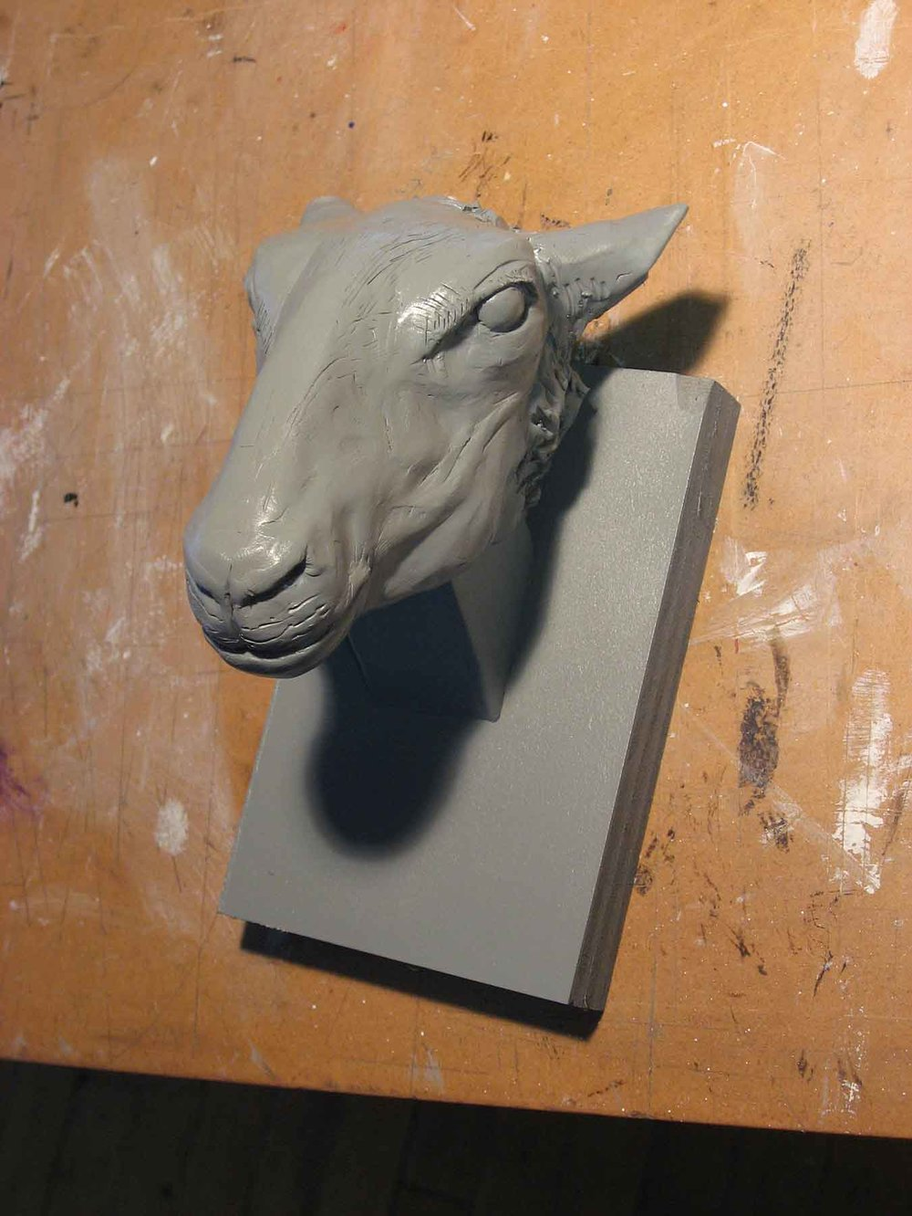And the final state: baked Sculpey once again, but painted gray. I think I added the gloss finish to be able to pick out the highlights more easily.