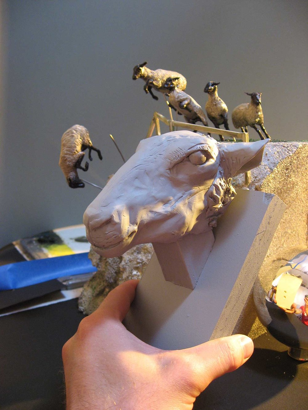 I photographed the head at different angles, to match the pose of the smaller figures. This gave me the desired, extra lighting details for each sheep.