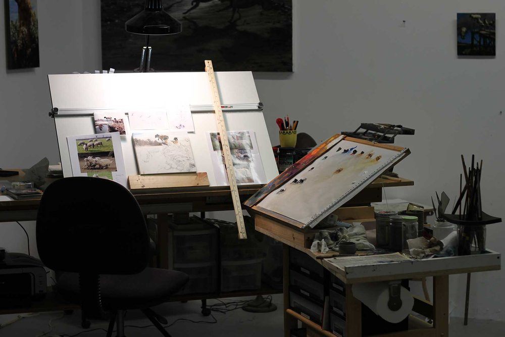 Here's a painting set up yours inspired. I bought a portable drafting board and installed a support behind it made of crossbars and the same drafting table hardware as the palette. This makes the board adjustable, and able to be stored when not in use. I liked experimenting with the ergonomics of painting this way - it made sense that scribes, engineers and illustrators have been using it for centuries!