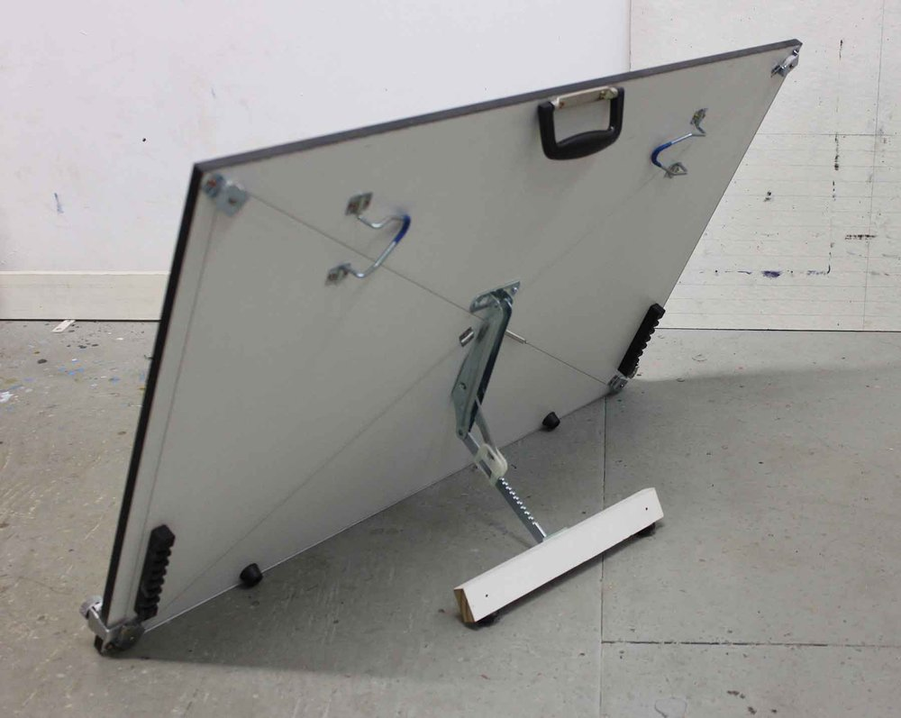 The back of the drafting board, showing the special hinge.