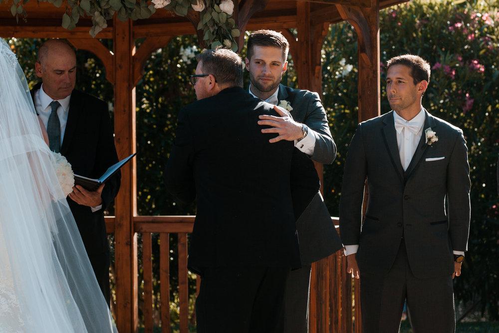Wedding Hand off Elliston Vineyard Sunol.jpg