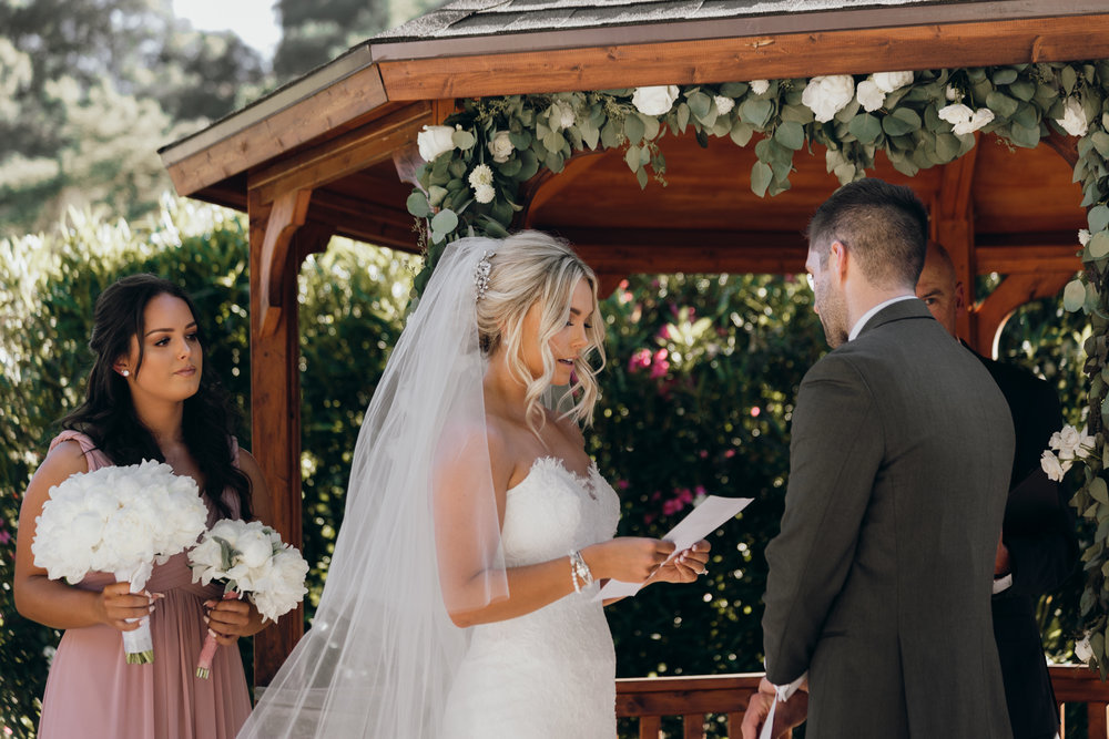 Bride reading vows Elliston Vineyard Sunol