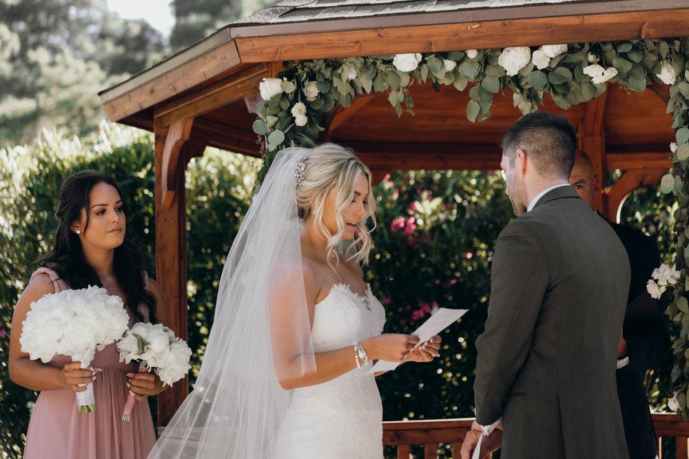 Bride reading vows Elliston Vineyard Sunol