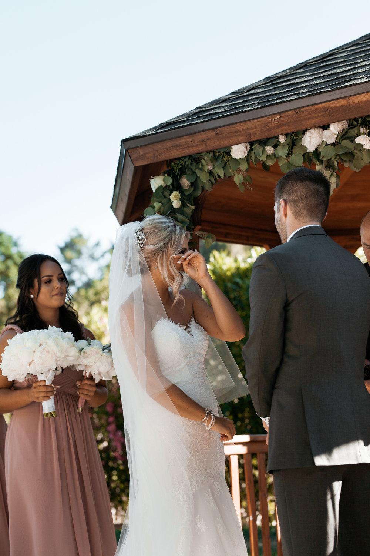 Bride during ceremony Elliston Vineyard Sunol.jpg