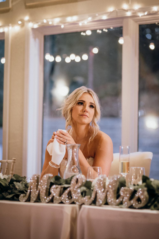 Bride during toasts Elliston Vineyard Sunol