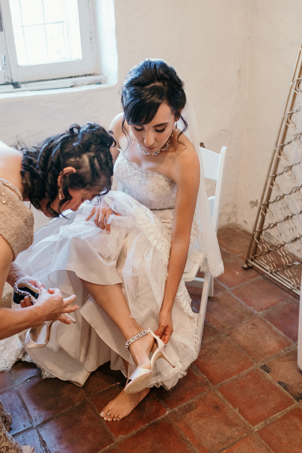 Mother of the Bride putting on Shoes