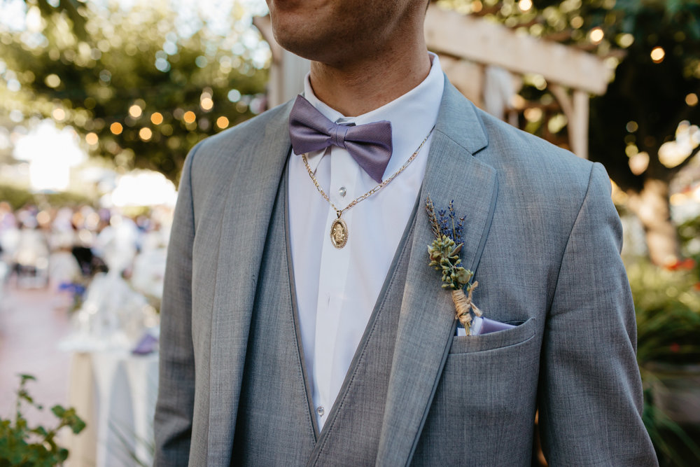 Groom with Lavender boutonniere