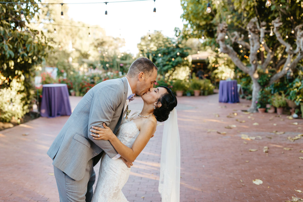 Jardines Outdoor Garden Wedding Reception Bride Groom kiss