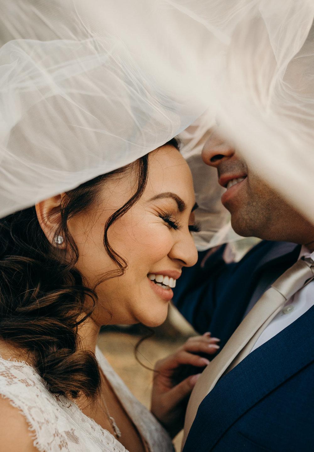 Bride and Groom Under Veil Palm Event Center Livermore