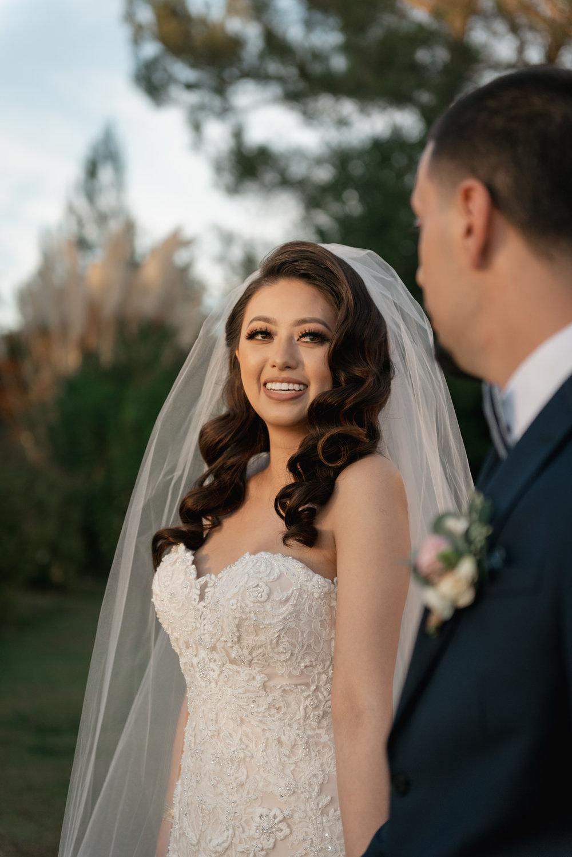bride looking at groom on wedding day