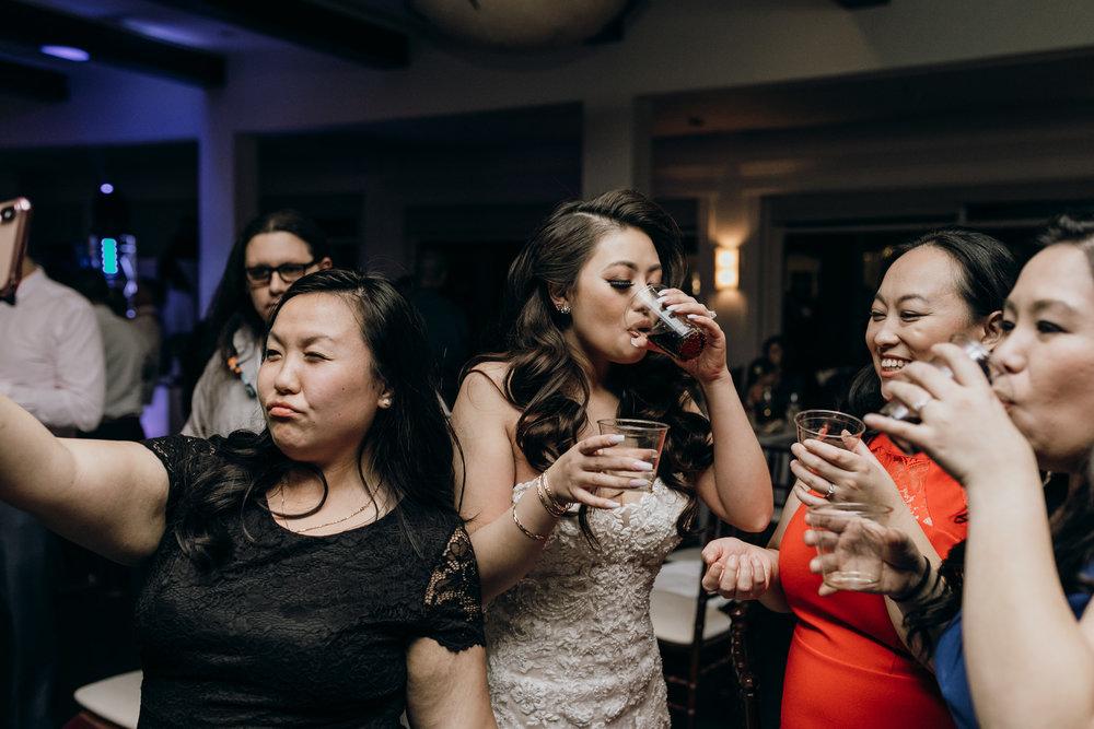 bride taking shots on wedding day