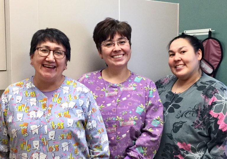 Aurora Johnson (center) with dental assistants Deborah Ivanoff and Jerilyn Alakayak.