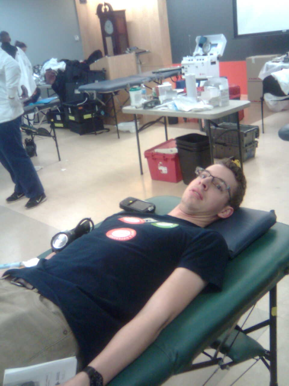Stephen Berry ('16) waits to have his blood drawn. Photo by Brian Stewart.